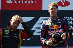 2nd place Kimi Raikkonen, Lotus F1 Team  with 1st place Sebastian Vettel, Red Bull Racing
