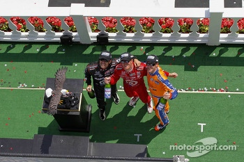 Race winner Scott Dixon, second place Charlie Kimball, third place Dario Franchitti