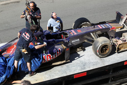 The Scuderia Toro Rosso STR8 of Daniil Kvyat, Scuderia Toro Rosso Test Driver is recovered back to the pits on the back of a truck