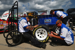 Crew members work on dirt tires