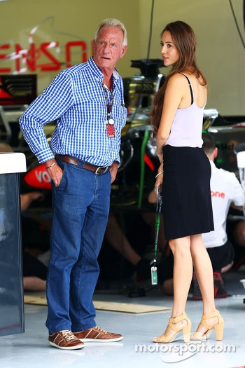 (L to R): John Button, with Jessica Michibata, girlfriend of Jenson Button, McLaren