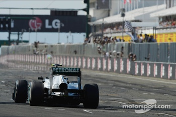 Race winner Lewis Hamilton, Mercedes AMG F1 W04 takes the chequered flag at the end of the race
