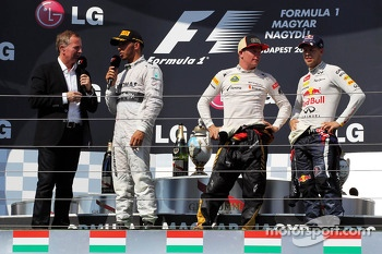 The podium: Martin Brundle, Sky Sports Commentator; Lewis Hamilton, Mercedes AMG F1; Kimi Raikkonen, Lotus F1 Team; Sebastian Vettel, Red Bull Racing