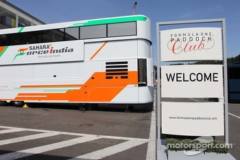Formula One Paddock Club sign and a Sahara Force India F1 Team truck.