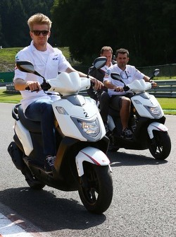 Nico Hulkenberg, Sauber rides the circuit on a moped.