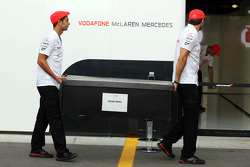 McLaren team members in retro kit celebrating 50 years as a constructor