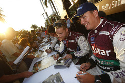 Mads Ostberg and the Qatar M-Sport World Rally Team sign autographs before the start of the 2013 Rally Australia