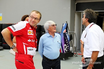 Stefano Domenicali, Ferrari General Director with Bernie Ecclestone, CEO Formula One Group, and Pasquale Lattuneddu, of the FOM