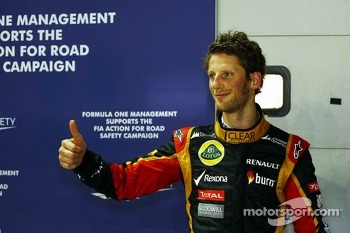 Romain Grosjean, Lotus F1 Team celebrates his third position in qualifying in parc ferme