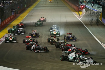 Lewis Hamilton, Mercedes AMG F1 W04 and Jenson Button, McLaren MP4-28 at the start of the race