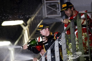 third placed Kimi Raikkonen, Lotus F1 Team and second placed Fernando Alonso, Ferrari celebrate with the champagne on the podium