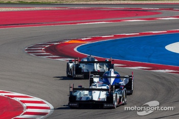 LMP1 prototypes racing close through the esses