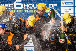 LMP2 podium: champagne for Roman Rusinov, John Martin and Mike Conway