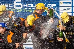 LMP2 podium: champagne for Roman Rusinov, John Martin and Mike Conway