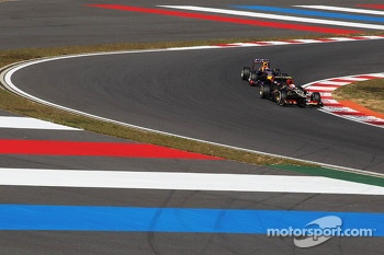 Romain Grosjean, Lotus F1 E21 leads Sebastian Vettel, Red Bull Racing RB9