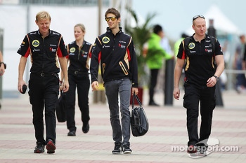 Romain Grosjean, Lotus F1 Team with Andy Stobart, Lotus F1 Team Press Officer