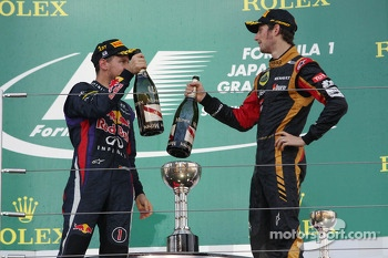 The podium: Sebastian Vettel, Red Bull Racing celebrates with third placed Romain Grosjean, Lotus F1 Team