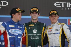 Race winner Alexander Rossi, second place Jolyon Palmer, third place Marcus Ericsson