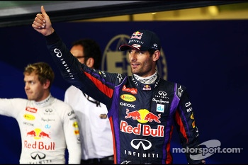Mark Webber, Red Bull Racing celebrates his pole position in parc ferme with team mate Sebastian Vettel, Red Bull Racing