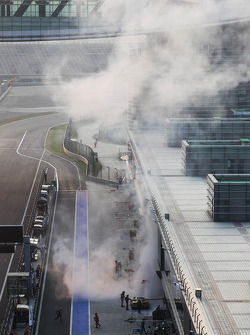 Smoke rises from the Larbre Competition Corvette