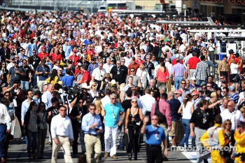Fans enjoy a pit lane walkabout
