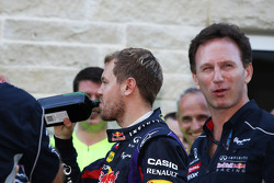 (L to R): Sebastian Vettel, Red Bull Racing with a bottle of Jagermeister and Christian Horner, Red Bull Racing Team Principal