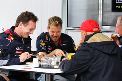 (L to R): Christian Horner, Red Bull Racing Team Principal has breakfast with Sebastian Vettel, Red Bull Racing; Niki Lauda, Mercedes Non-Executive Chairman and Christian Horner, Red Bull Racing Team Principal