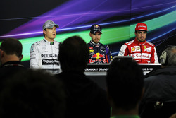 Qualifying top three in the FIA Press Conference: Nico Rosberg, Mercedes AMG F1, second; Sebastian Vettel, Red Bull Racing, pole position; Fernando Alonso, Ferrari, third