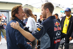 (L to R): Emerson Fittipaldi, with Sebastian Vettel, Red Bull Racing