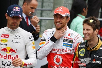 (L to R): Mark Webber, Red Bull Racing; Jenson Button, McLaren; and Romain Grosjean, Lotus F1 Team on the drivers parade
