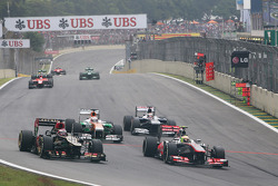 Sergio Perez, McLaren MP4-28 and Heikki Kovalainen, Lotus F1 E21 battle for position