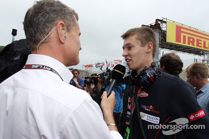 (L to R): David Coulthard, Red Bull Racing and Scuderia Toro Advisor / BBC Television Commentator with Daniil Kvyat, Scuderia Toro Rosso on the grid