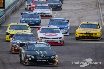 Kyle Busch leads the field on pitlane