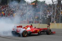Felipe Massa, Ferrari F138 celebrates at the end of the race with donuts