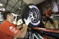 Imperial Toyota Hilux team members load tires