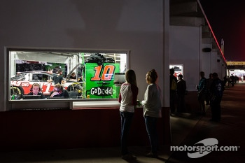 Young female fans watch the garage of Danica Patrick, Stewart-Haas Racing Chevrolet