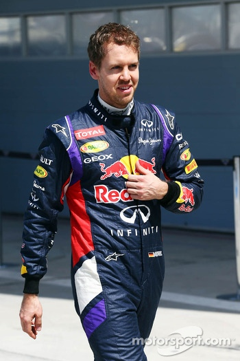 Sebastian Vettel, Red Bull Racing after his Red Bull Racing RB10 stopped at the pit exit