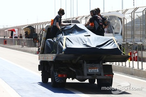 The Red Bull Racing RB10 of Sebastian Vettel, Red Bull Racing is recovered back to the pits on the back of a truck