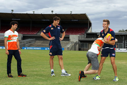 (L to R): Sergio Perez, Sahara Force India F1 and Will Minson, Western Bulldogs Australian Rules Footballer watch on as Nico Hulkenberg, Sahara Force India F1 practices his Aussie Rules skills on Shaun Higgins, Western Bulldogs Australian Rules Footballer