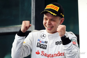 Kevin Magnussen, McLaren celebrates his third position on the podium