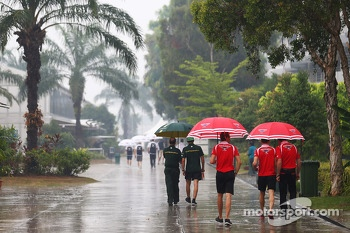 (L to R): Jules Bianchi, Marussia F1 Team and Max Chilton, Marussia F1 Team in a wet and rainy paddock
