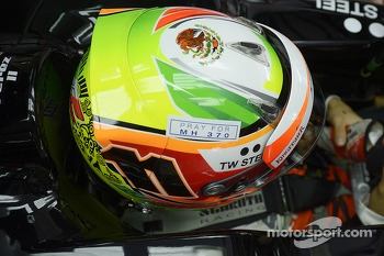 Sergio Perez, Sahara Force India F1 VJM07 with a tribute to flight MH370 on his helmet