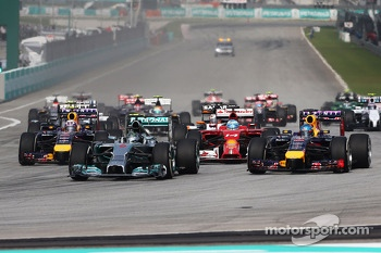Nico Rosberg, Mercedes AMG F1 W05 and Sebastian Vettel, Red Bull Racing RB10 at the start of the race