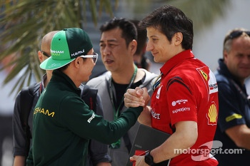 (L to R): Kamui Kobayashi, Caterham with Massimo Rivola, Ferrari Sporting Director