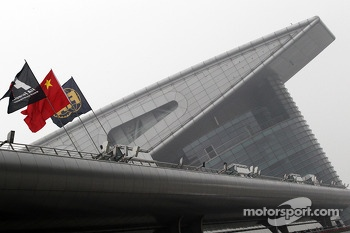 Chinese, F1 and FIA Flags in the paddock