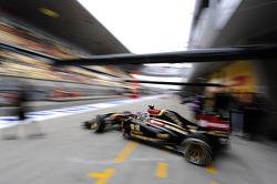 Romain Grosjean, Lotus F1 E22 leaves the pits