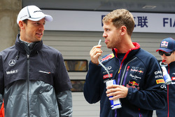 Jenson Button, McLaren with Sebastian Vettel, Red Bull Racing on the drivers parade.