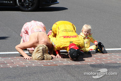 Ryan Hunter-Reay of Andretti Auto Sport along with his wife Beccy and son Ryden kiss the bricks at the Indianapolis Motor Speedway after winning the 98th Running of the Indianapolis 500 Mile Race.