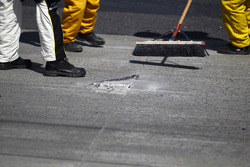 Crews work to repair damaged concrete on the track surface