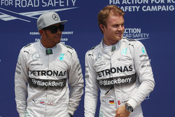 Nico Rosberg, Mercedes AMG F1, celebrates his pole position with team mate Lewis Hamilton, Mercedes AMG F1